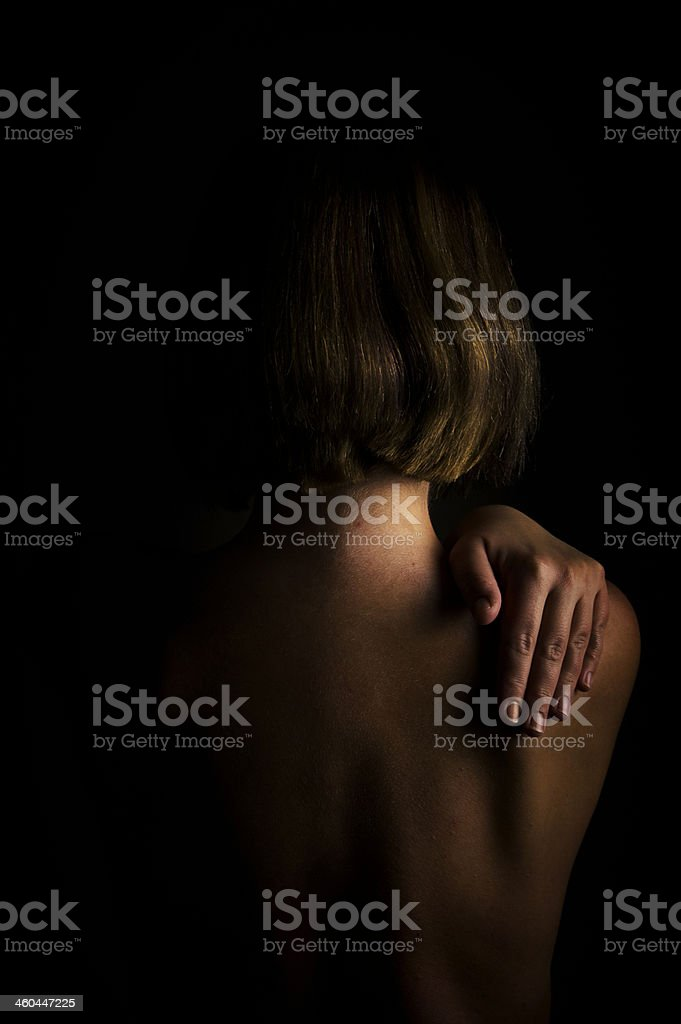 Low light portrait of young woman royalty-free stock photo