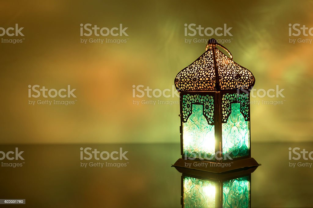 Low light view of colored Lantern on a glass stock photo