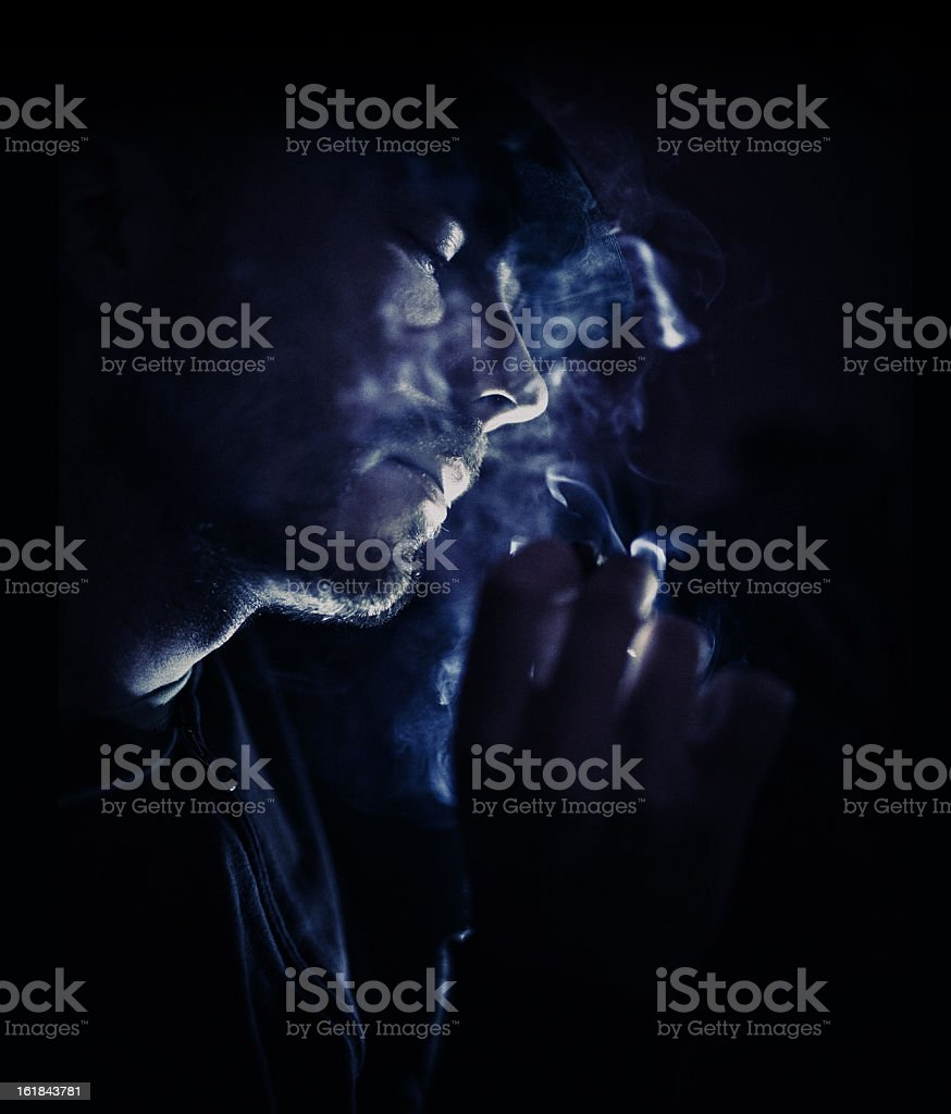 low ligth smoking stock photo