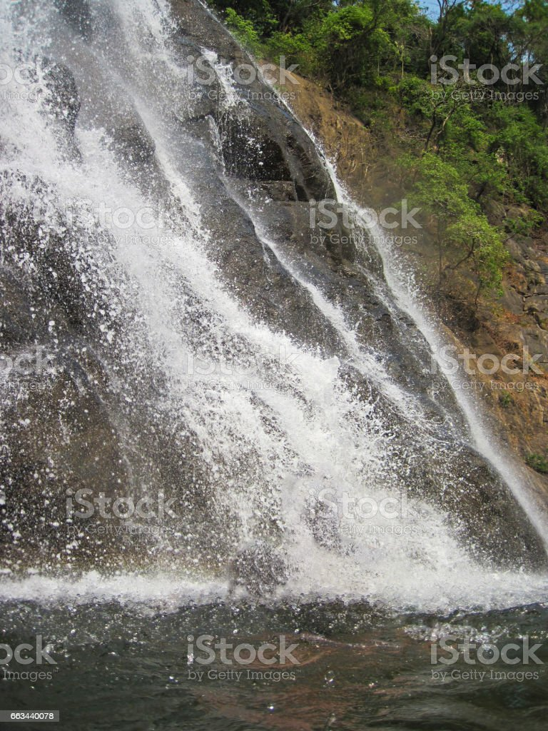 Low natural waterfall in Asia stock photo