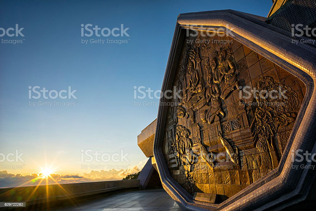 Low Relief on Phra Mahathat Naphamethanidon stock photo