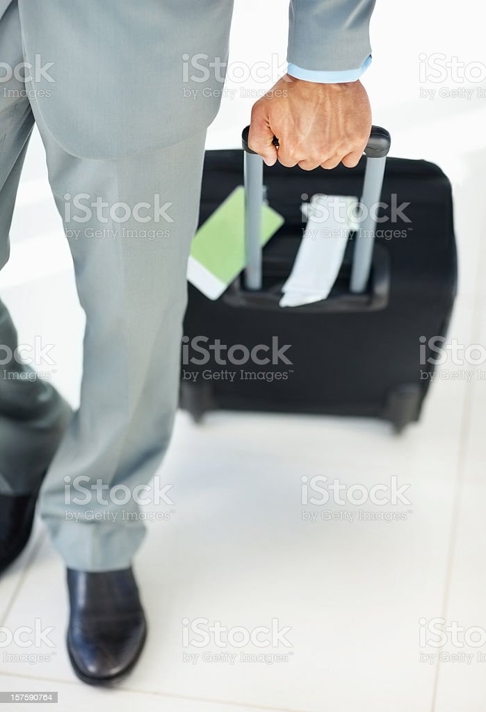 Low section of a business man with trolley bag royalty-free stock photo