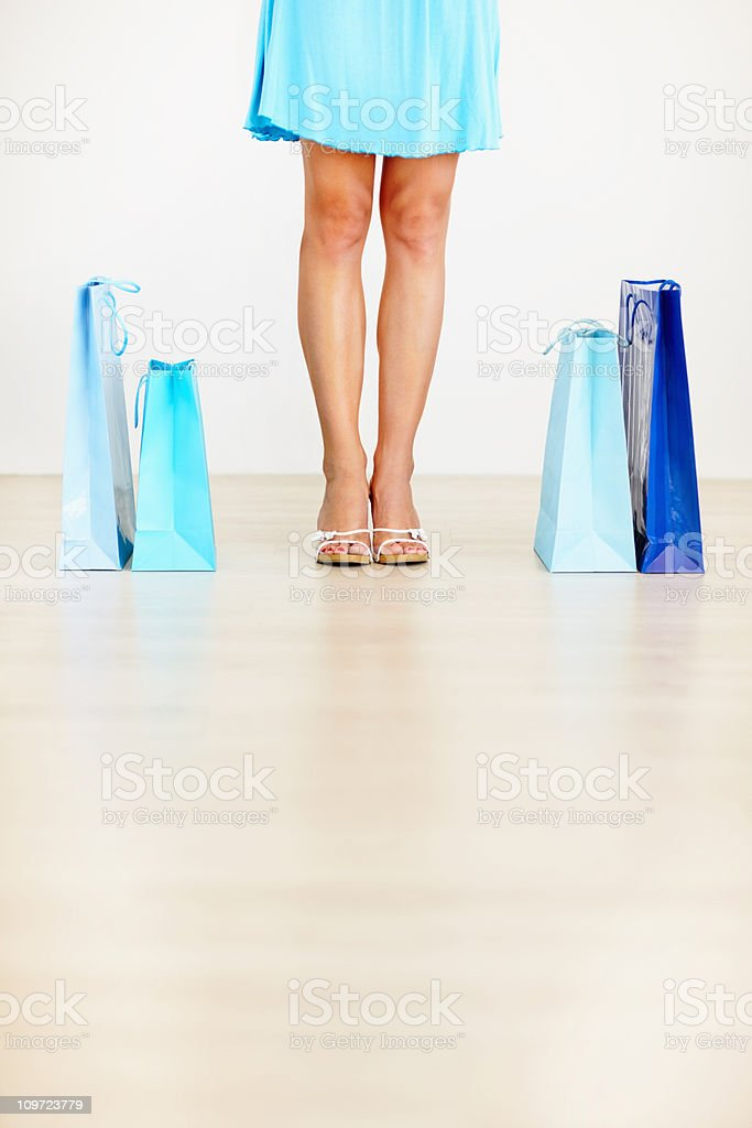 Low section of a female shopper with her shopping bags royalty-free stock photo
