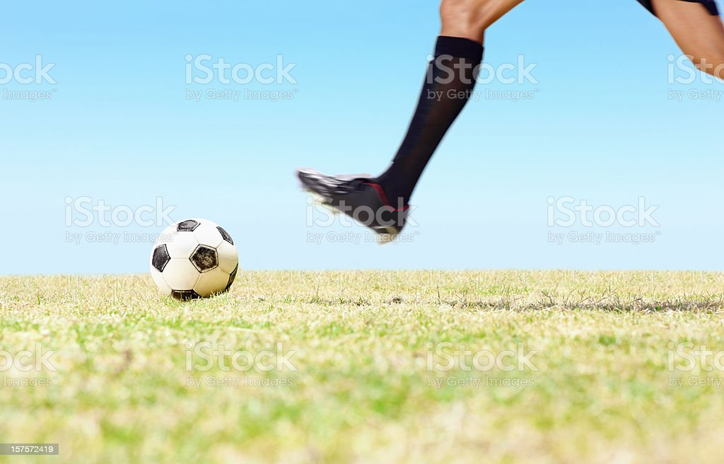 Low section of a football player playing on field royalty-free stock photo