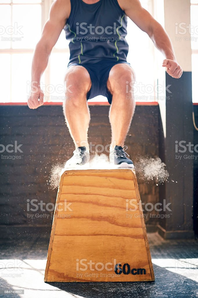 Low section of athlete exercising on box jump stock photo