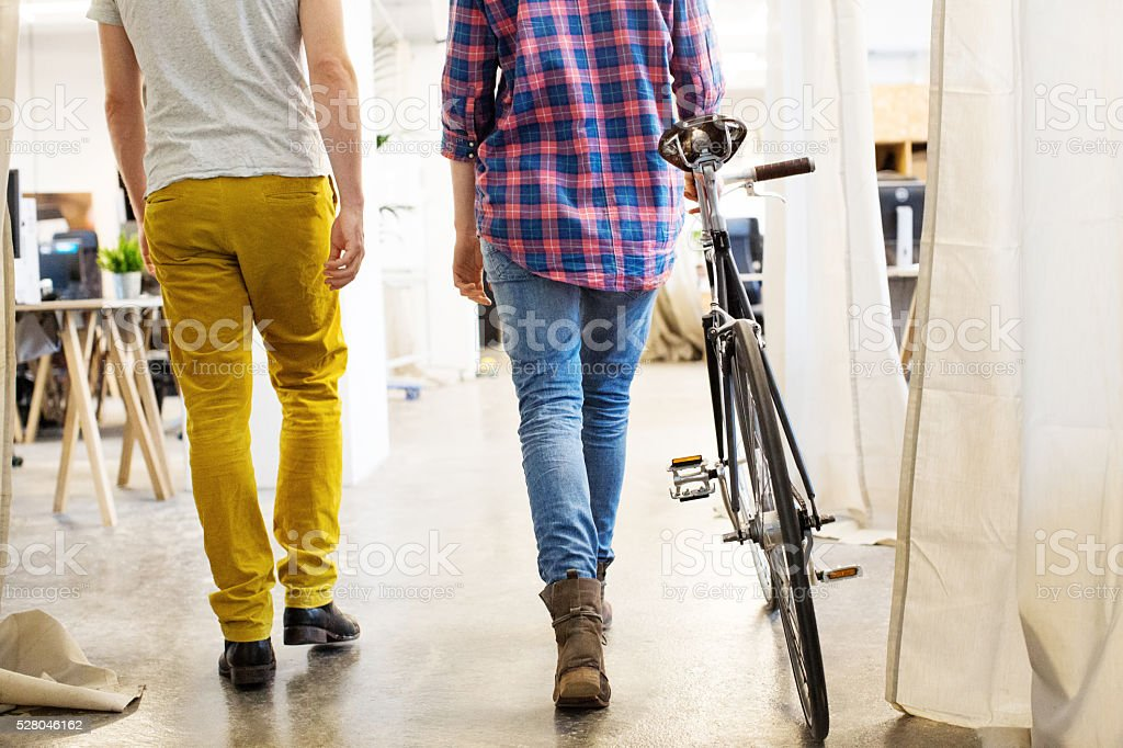 Low section of business people with bicycle stock photo