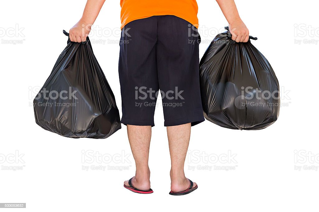 Low section of man carrying garbage bags isolated on white stock photo