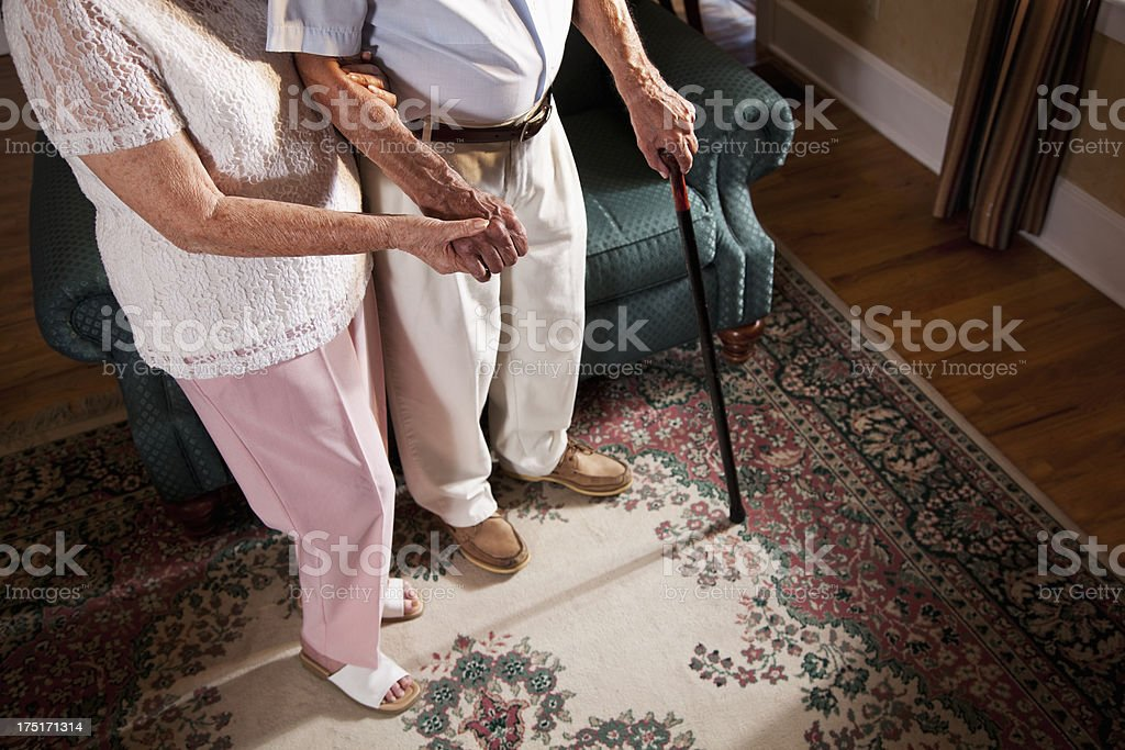 Low section of senior couple at home stock photo