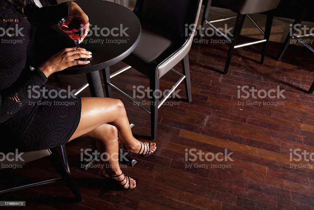 Low section of woman drinking cocktail stock photo