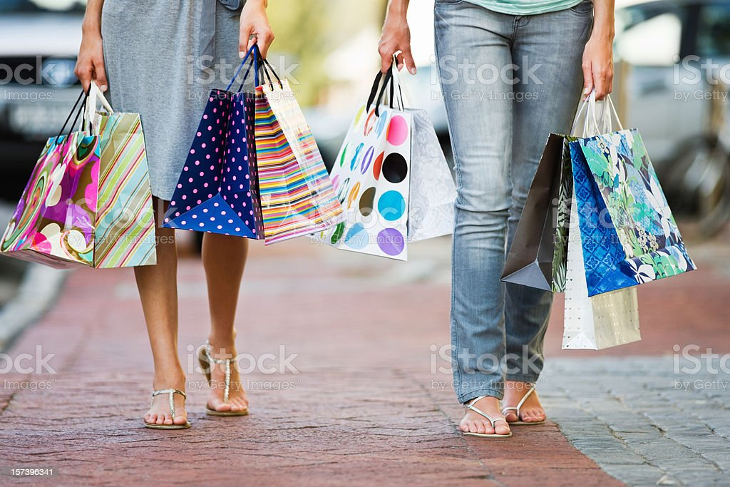 Low section of young friends holding shopping bags royalty-free stock photo