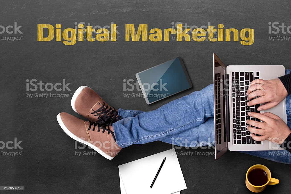 Low section view of a businessman doing digital marketing stock photo