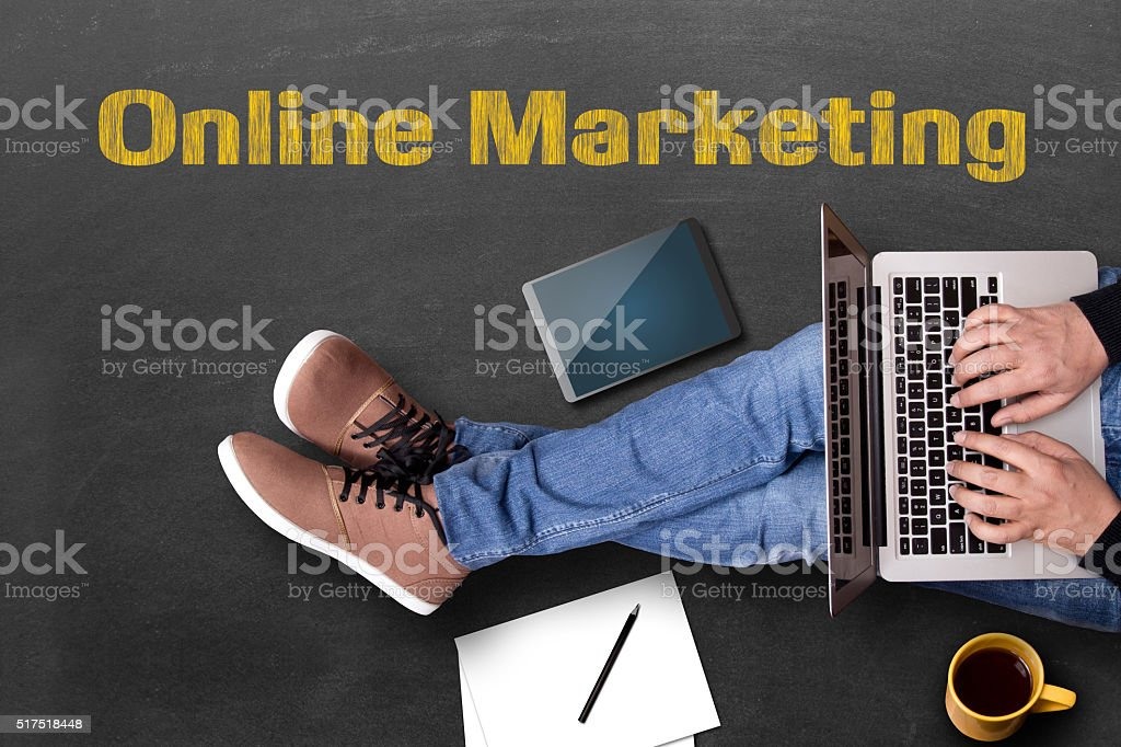 Low section view of a businessman doing online marketing stock photo