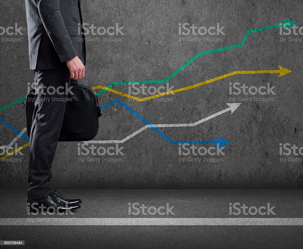 Low section view of a businessman standing with bar graph stock photo