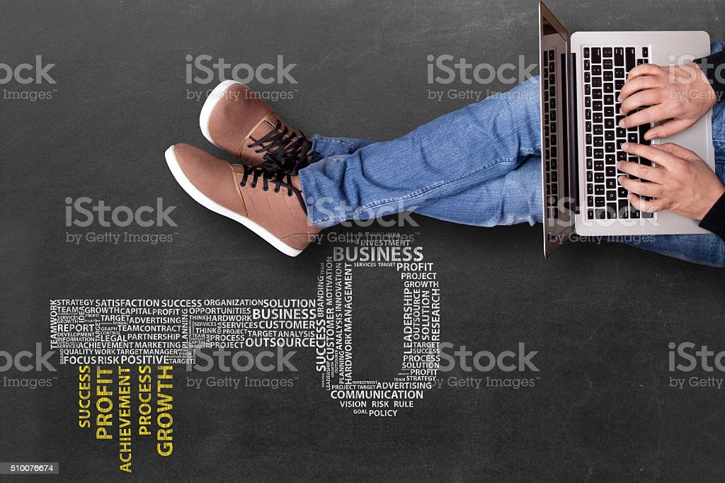 Low section view of a businessman using laptop stock photo