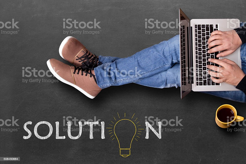 Low section view of a man using laptop stock photo