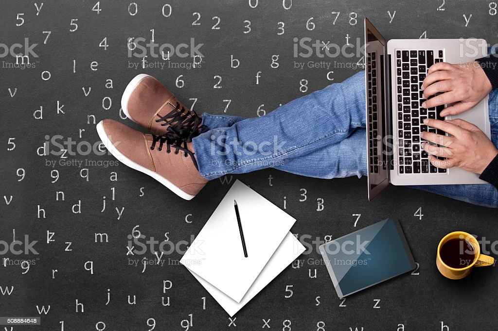 Low section view of a student using laptop stock photo