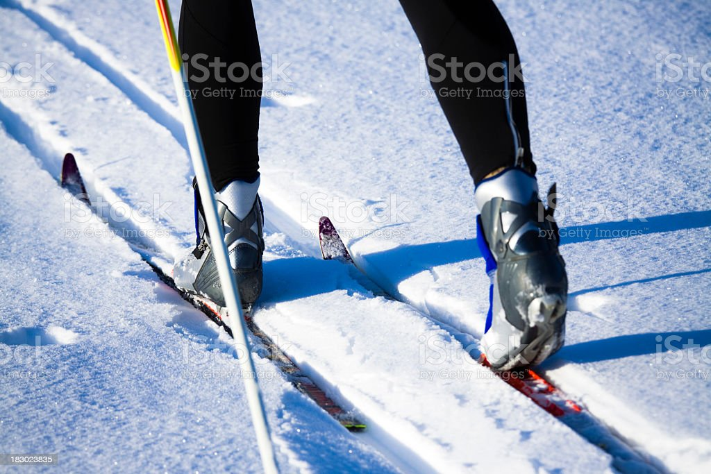 Low shot of skis and feet in Nordic skiing stock photo