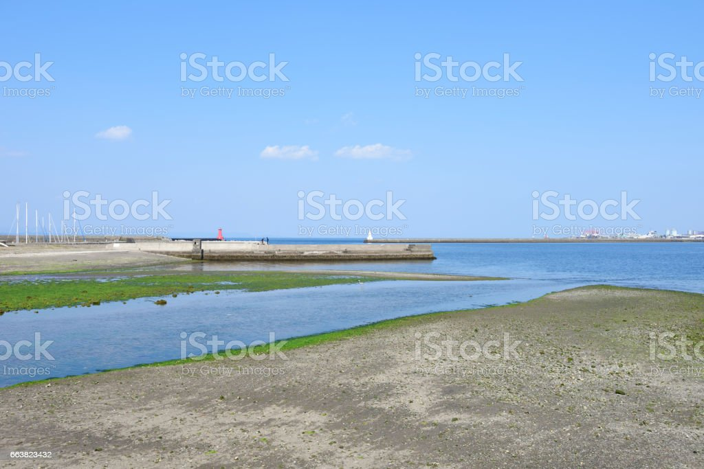 Low tide against clear sky stock photo