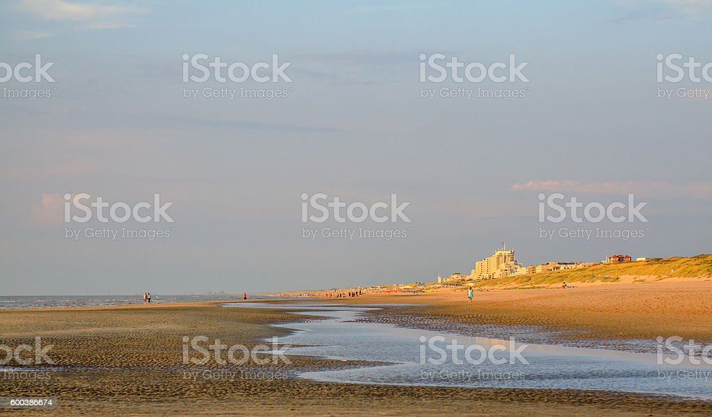 Low tide and sunset at the beach of Noordwijk stock photo