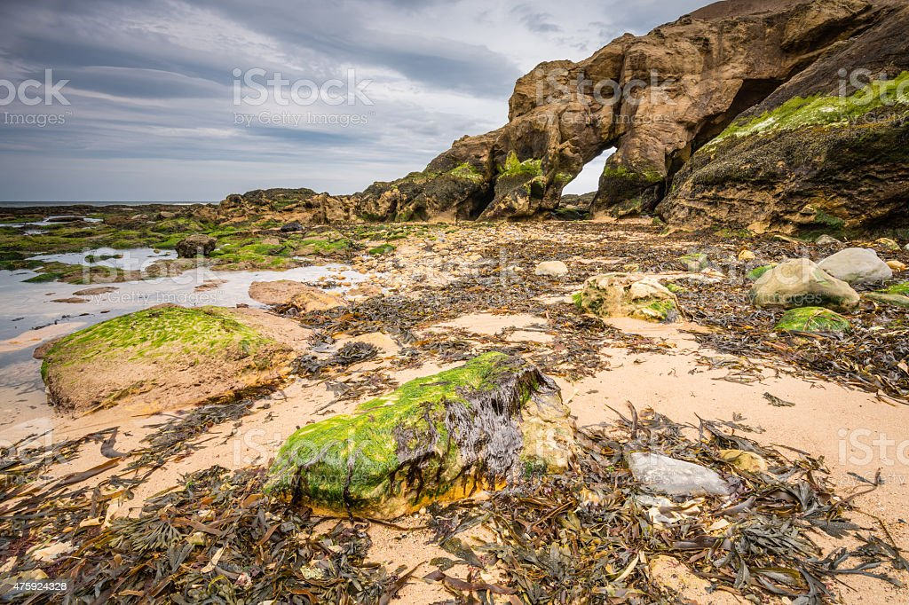 Low tide at Saddle Rocks stock photo