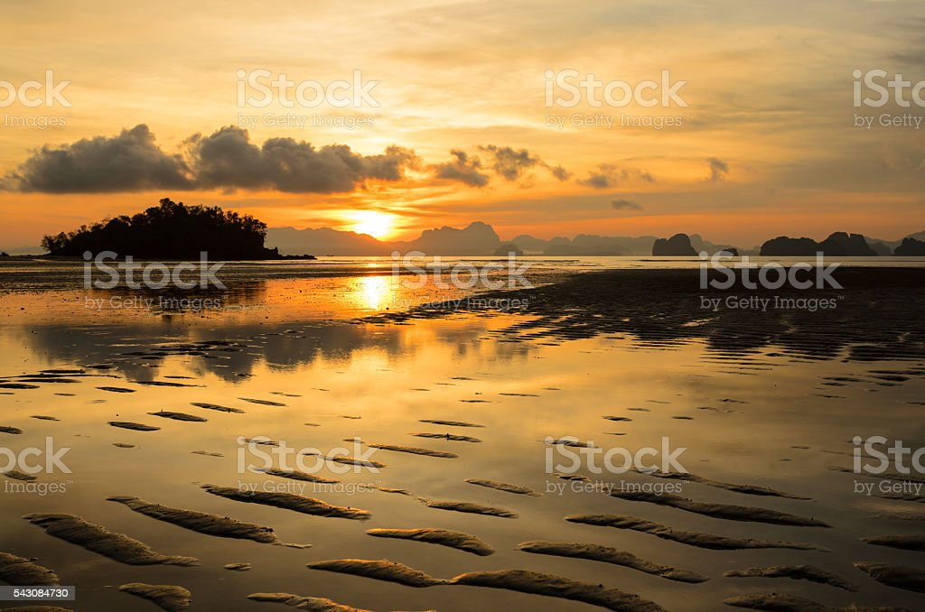 Low tide at tropical beach stock photo