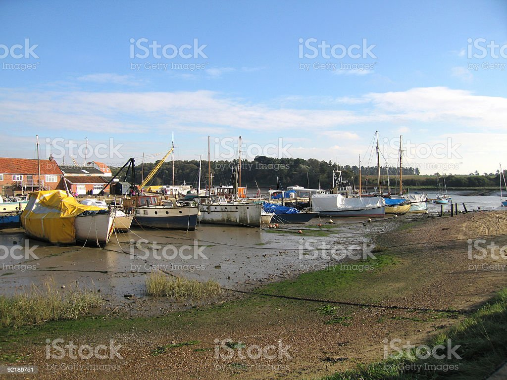 Low tide at Woodbridge, Suffolk - sailing boats on mud stock photo