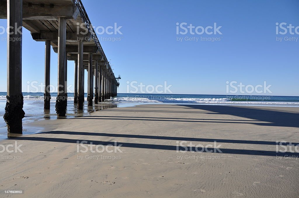 Low tide by the pier royalty-free stock photo