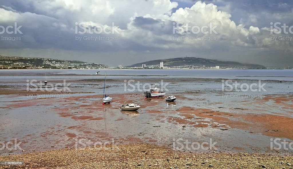 Low tide in the Swansea Bay, dramatic sky - Wales stock photo