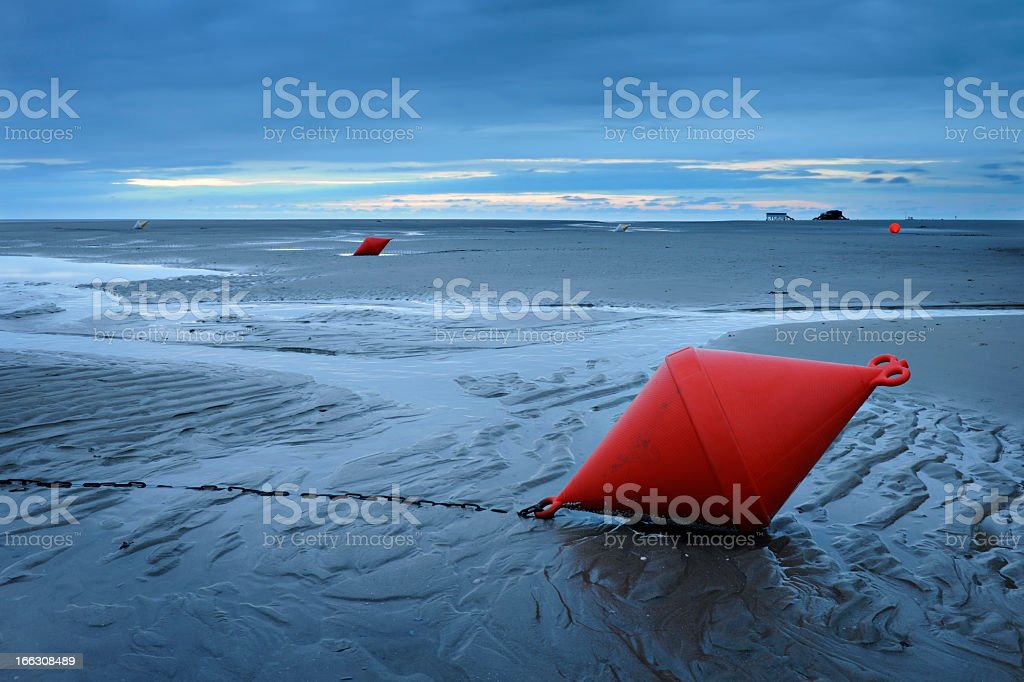 Low Tide Sunset on Endless Beach with Buoy stock photo