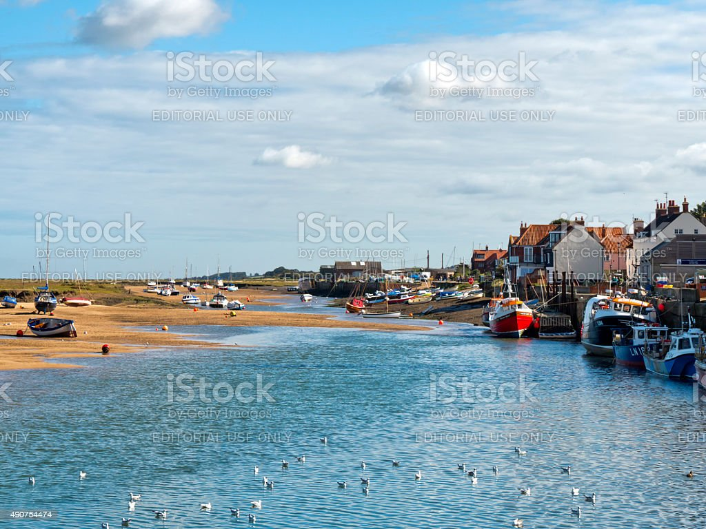 Low tide with seagulls at Wells-next-the-Sea stock photo