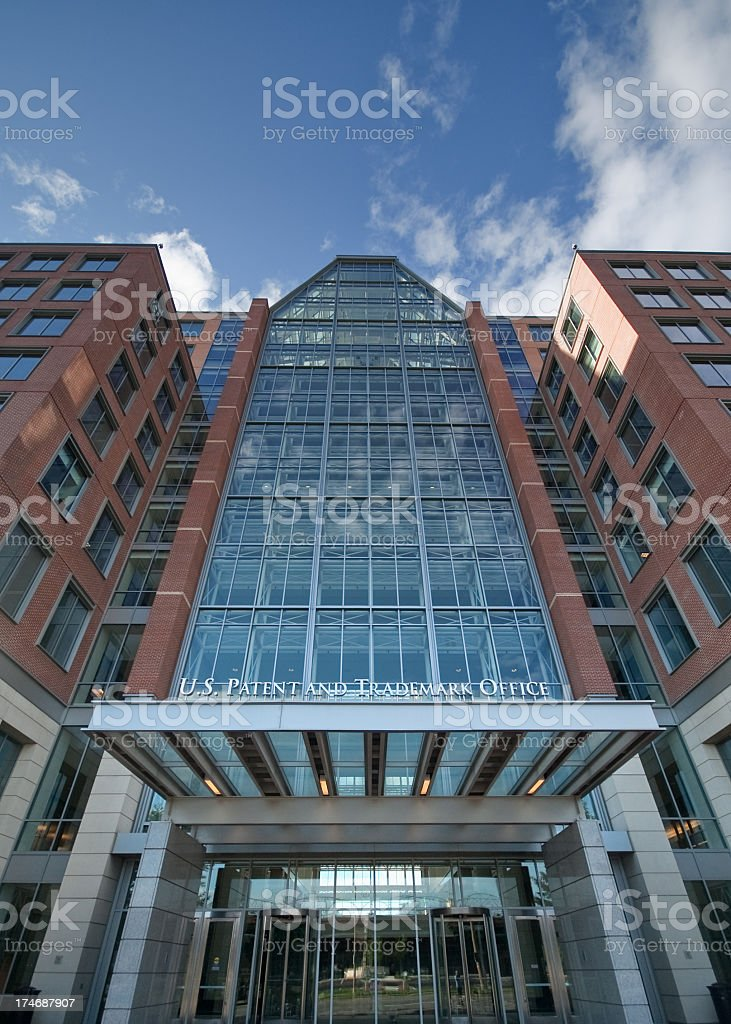 Low view of a modern office building standing tall stock photo