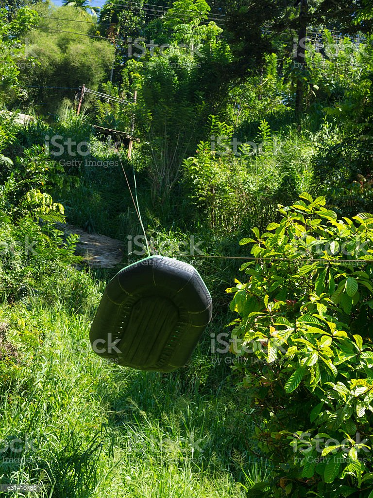 Low view of descending boat on cable for rafting stock photo