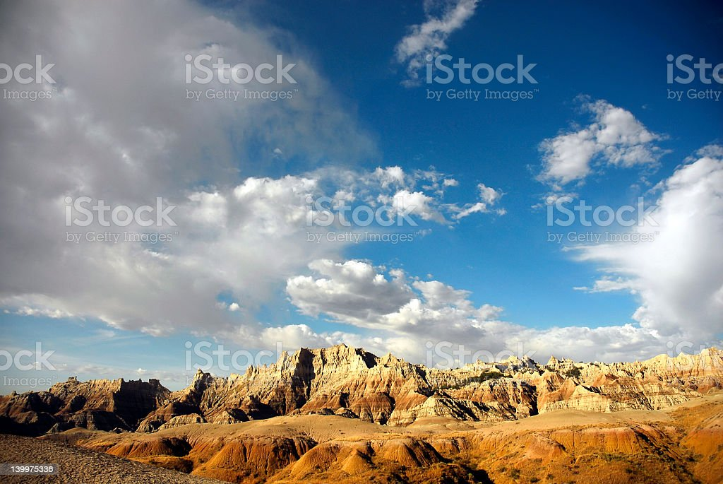 Low view of deserted badlands with clouds floating above stock photo