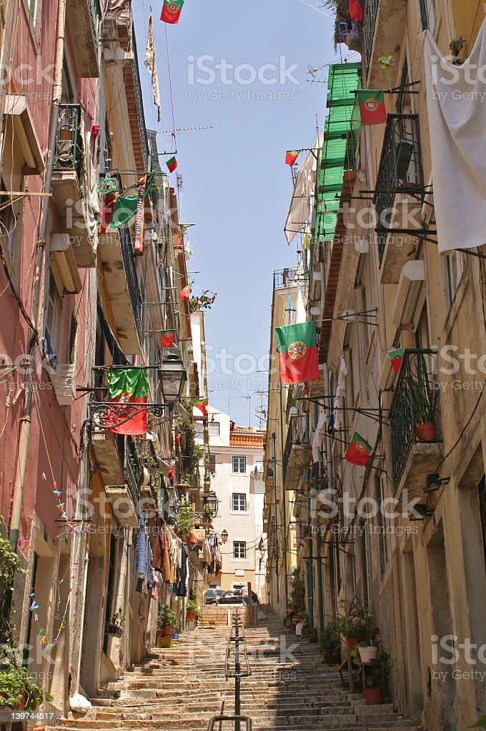 Low view of Portuguese balconies on either side of walkway  royalty-free stock photo