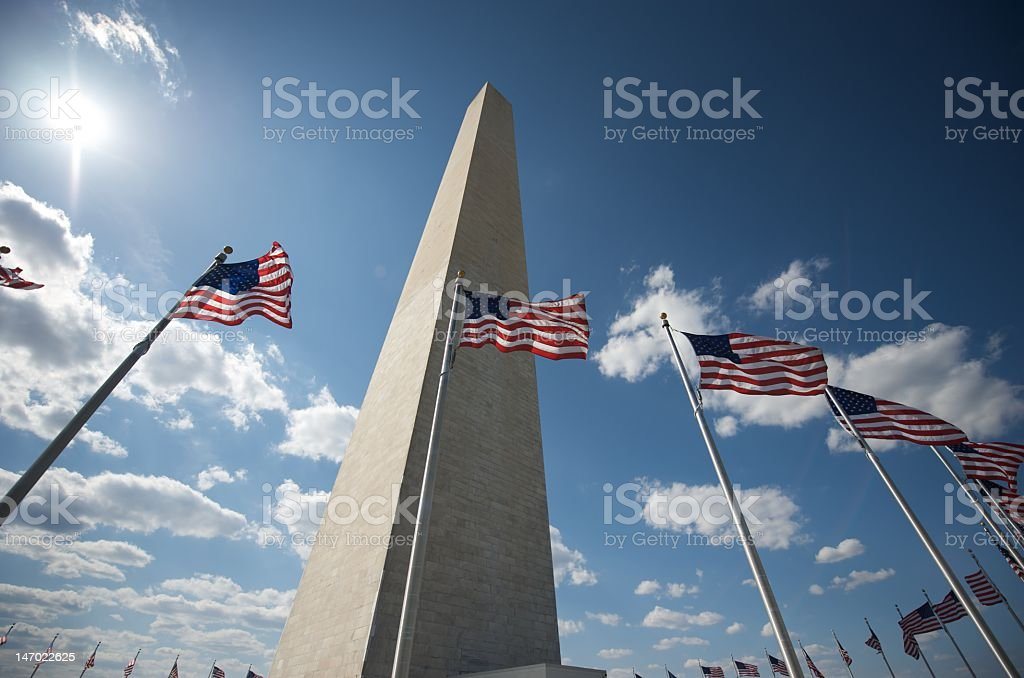 Low view of the Washington Monument with flags in front stock photo