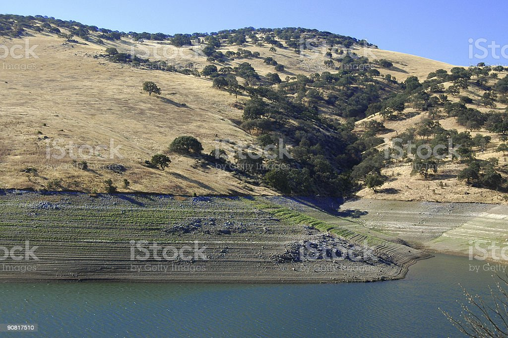 low water in reservoir during drought in California stock photo