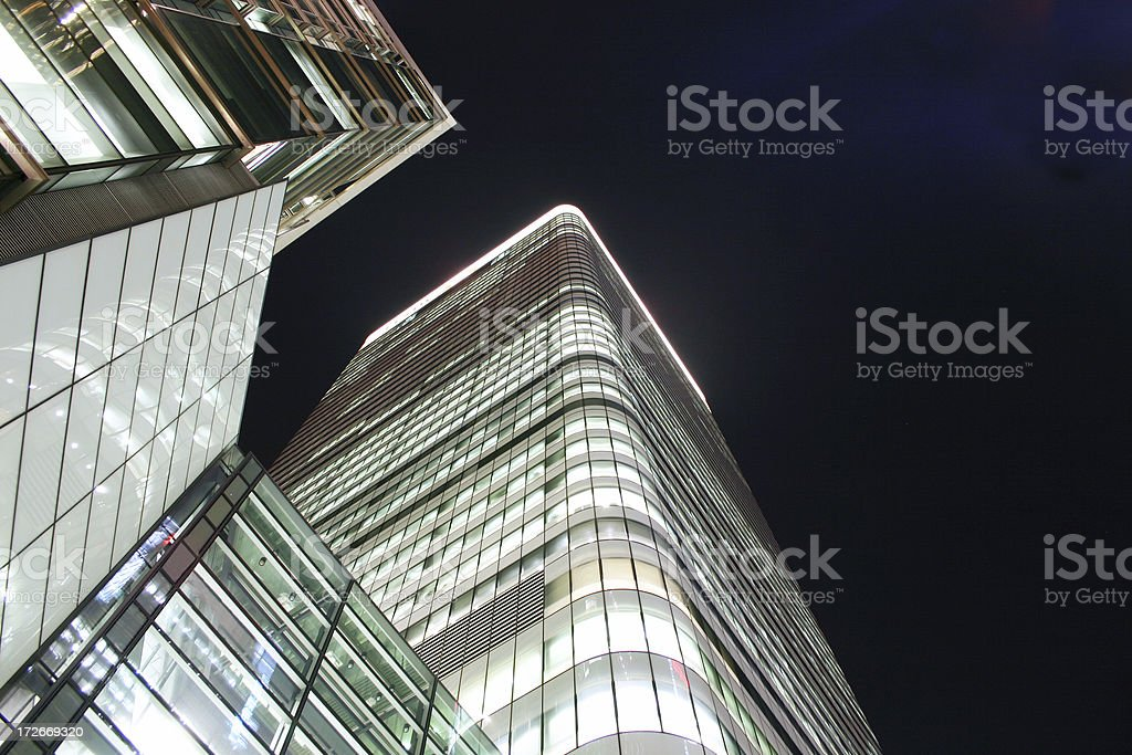 Low, wide angle night view of a contemporary skyscraper royalty-free stock photo