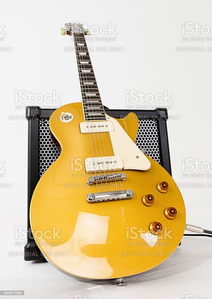 Low-angle look at '56 Les Paul Pro guitar with amplifier stock photo