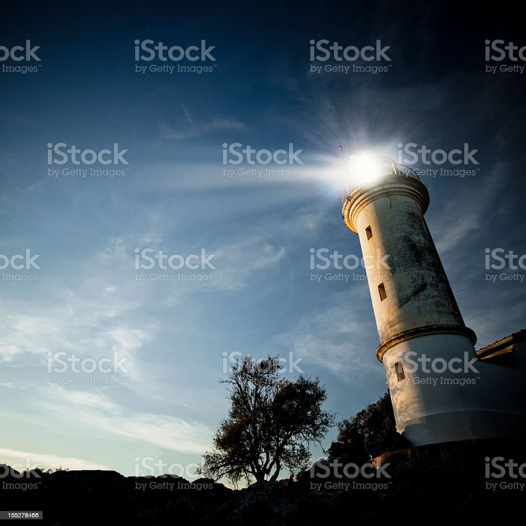 Low-angle view of a lighthouse at twilight stock photo