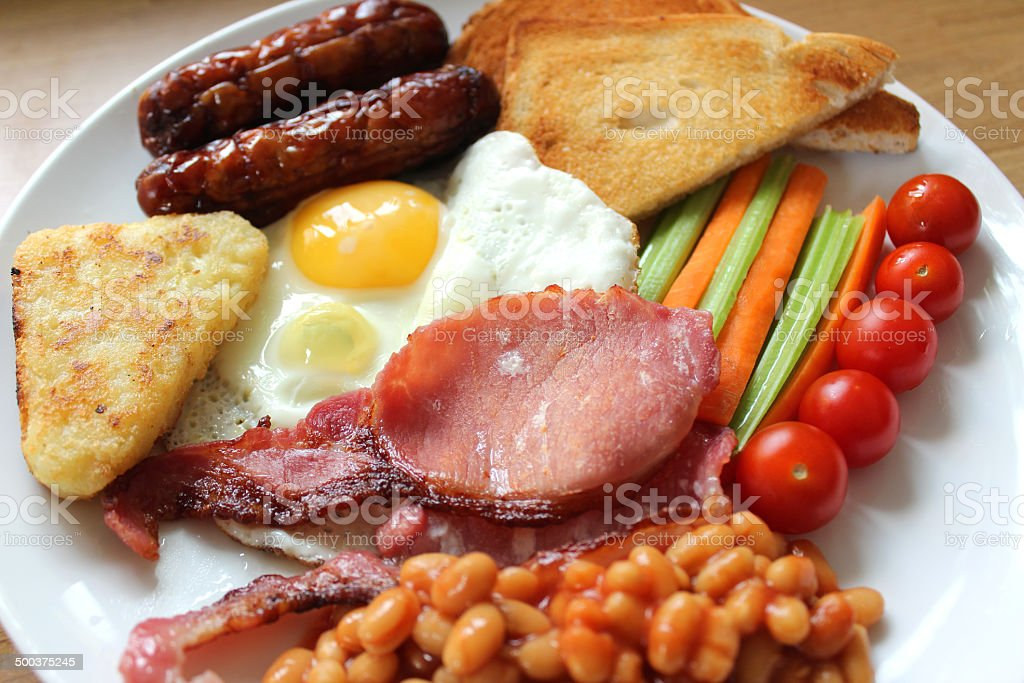 Low-calorie, full-English fried breakfast with healthy elements, raw vegetables, diet stock photo
