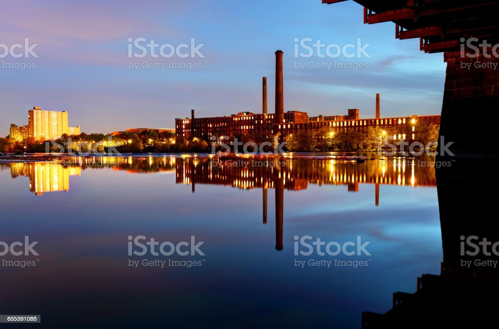 Lowell Mills Reflecting on the Merrimack River stock photo