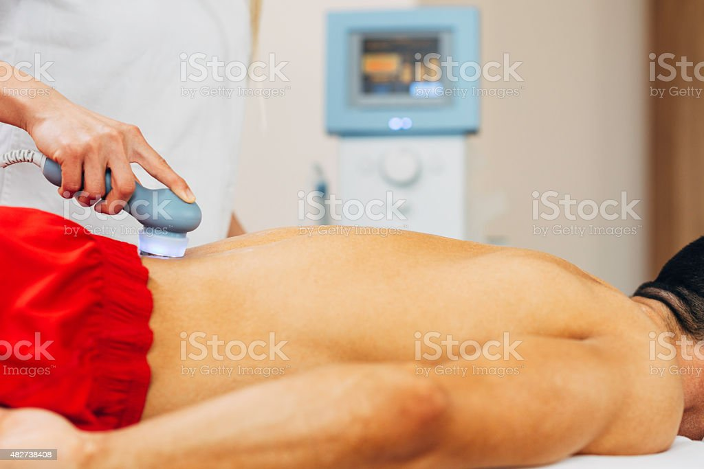 Lower back ultrasound therapy stock photo