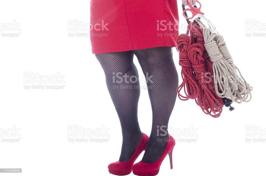 Lower body of woman swinging rope. stock photo