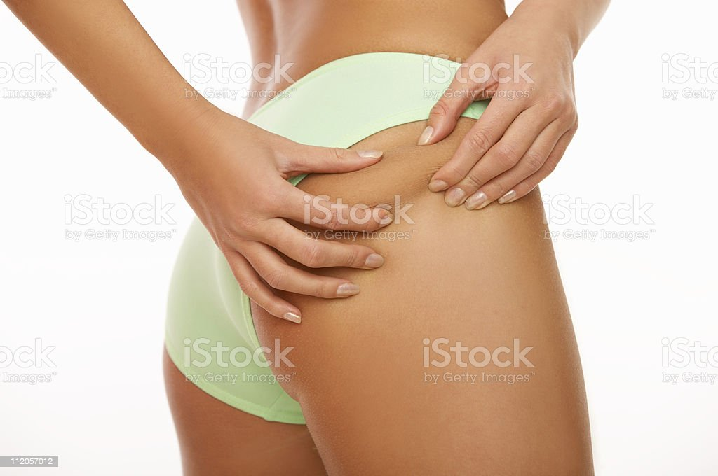 A lower body shot of a lady pinching her own bottom royalty-free stock photo