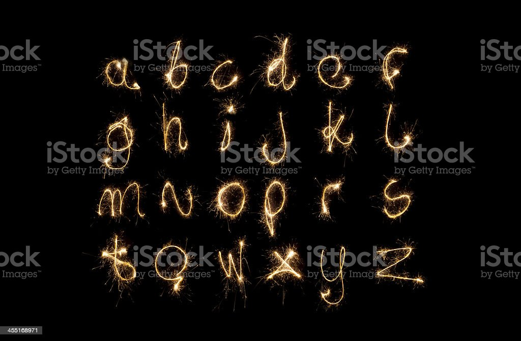 Lower case alphabet made from pyrotechnics stock photo