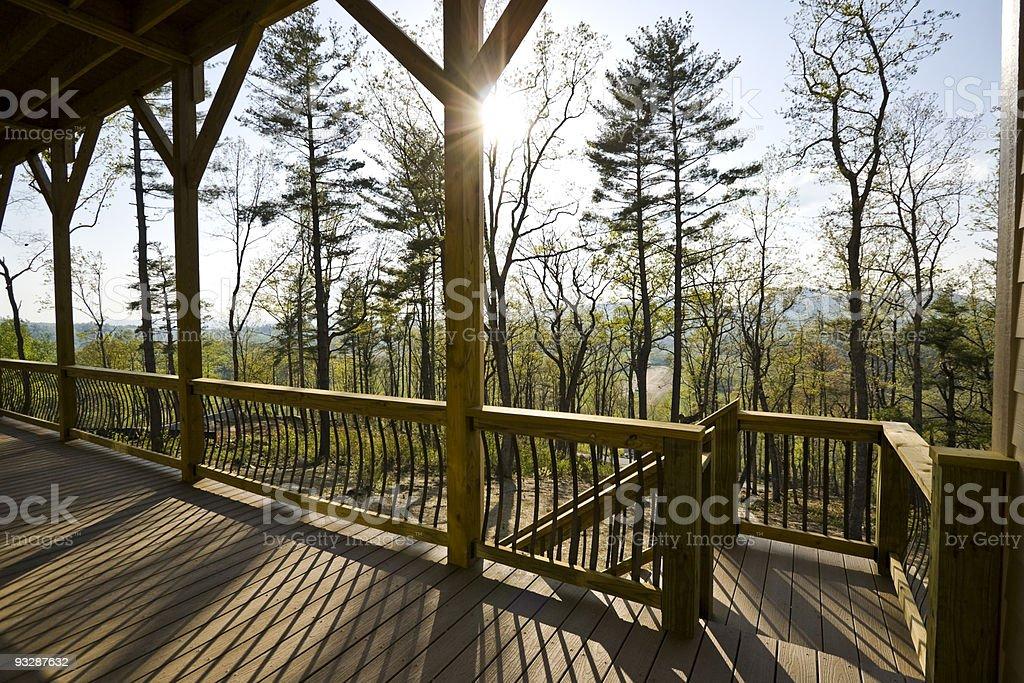 Lower deck view of afternoon sunburst peeking through the trees. stock photo