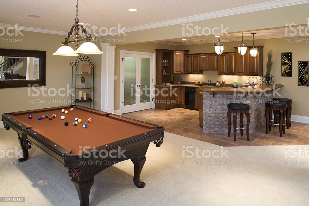 Lower level game room and bar in residential home. royalty-free stock photo