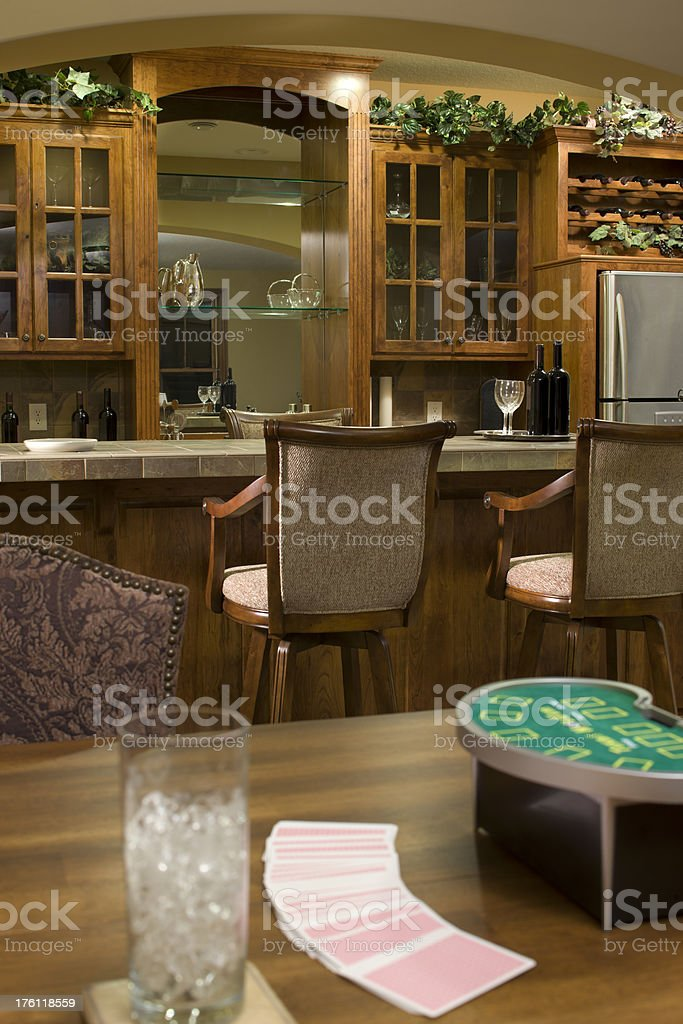 Lower level game room and bar in residential home. stock photo