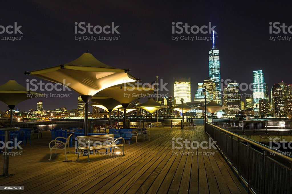 Lower Manhattan skyline at night from Exchange Place, NJ stock photo