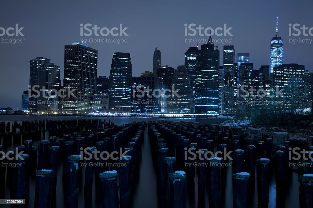 Lower Manhattan skyline night view from Brooklyn Bridge Park stock photo